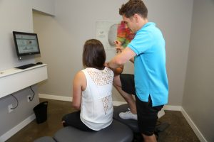 oliver chiropractor treating a patient